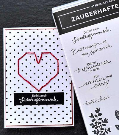 valentinstagskarte auf gepuntetem Papier mit gesticktem herz